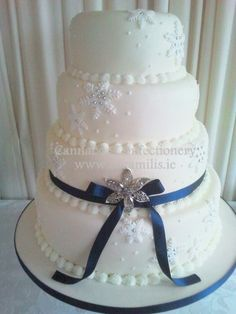 Snowflake wedding cake by Cannaboe Confectionery. Check out our Cannaboe Confectionery facebook page or follow us  @Cannaboe Confectionery Confectionery on twitter. You can purchase the snowflake cutter through our shop at www.cacamilis.ie