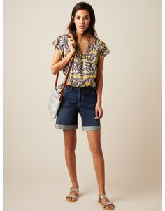 Brighten up your wardrobe and your day with our Camelia top. With a central front pleat for a relaxed fit, it features a batik inspired print, cap sleeves and a notch neck. In cotton, it will keep you cool whilst looking stylish. Yellow Print, Boutique, White Outfits, Cap Sleeves, White Stuff, Knitwear, Denim Shorts, Clothes For Women, Stylish