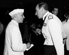Viceroy's Independence Day party for Americans in New Delhi, India, July 4, 1947.  Jawaharlal Nehru on the left and the British Viceroy, Lord Louis Mountbatten.