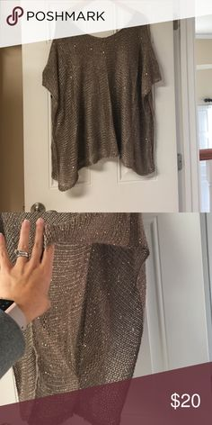 Brown poncho Hand made poncho with sequence scattered to give this piece of outerwear a formal or casual look depending on what you pair it with.it has a large open side/sleeve as shown in pictures. There is brown, black or grey Sweaters Shrugs & Ponchos
