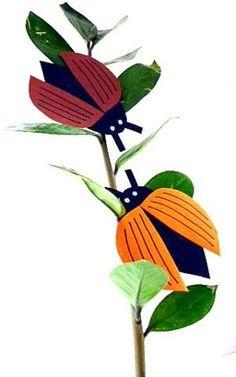 bastelsachen/basteln-Maikaefer-auf-Pflanze