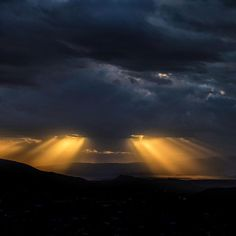 """Photo @ladzinski / Golden beams of sun breaking through storm clouds and warming up the hills of South West Utah. This is a classic scene of complimentary colors, meaning, that when paired together each color is amplified creating the strongest contrast. Leonardo da Vinci once observed that """"the finest harmonies were those between colors exactly opposed"""""""