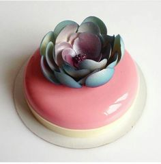 Mirror cake. Pink with a blue and purple flower