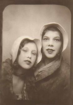 Young ladies in photo booth, ca. '30s