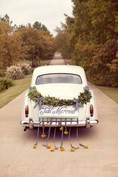 Gorgeous vintage get-away car.  Photo by Sarah Kate Photographer.  www.wedsociety.com  #wedding #transportation