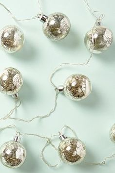 Silver glass string lights. Love these! | Anthropologie
