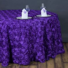 """132"""" Purple Wholesale Grandiose Rosette 3D Satin Round Tablecloth For Wedding Party Event /  Add oodles of flair and character in your party with our enticing raised rosette tablecloth, which is simply breathtaking. The very sight of this floral ecstasy will bring the divine vision of a paradise garden with its whimsical blossoms and luster into your event/celebration. For those special and rare celebrations that need to have an extra doting touch in their ambiance decoration, this top-notch…"""