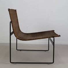 Gregorio Vicente Cortes & Luis Onsurbe; Enameled Metal and Wicker Lounge Chair, c1960.
