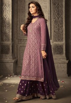 Faux Georgette Sharara Lehenga in Wine This attire with Poly Shantoon Lining is Prettified with Resham, Zari, Stone and Patch Border Work Available with a Dusty Pink Semi-stitched Faux Georgette Kameez Crafted in V Neck and Full Sleeve and a Wine Faux Chiffon Dupatta The Unstitched Lehenga Waist and Hips are Customizable from 28 to 36 and 36 to 44 inches respectively and the Length of the Lehenga and Kameez are 42 and 48 inches respectively Do note: The Length may vary upto 2 inches…