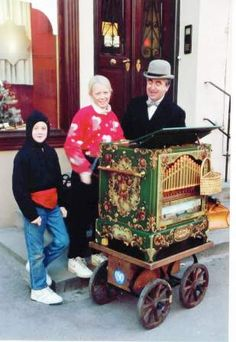 my kids & the organ grinder, nordlingen, germany, 1990...which one is the organ grinder's monkey !?!?!?