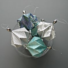This origami shape would work for a beautiful book page necklace. A You-tube tutorial is provided.