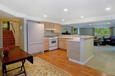 This home has entertaining in the basement with its own kitchen, and entertaining area, plus access to outside. 112 Woodlands Rd, Harrison, NY 10528 - #: 3331411