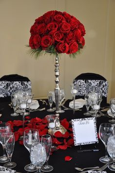 red, black and white winter  decor - love the red rose centerpiece - stunning!