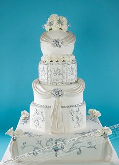 Wedding cake. I LOVE the different shapes and sizes of the tiers.