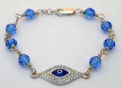 Handmade Swarovski crystal evil eye wire by FlyBellaDesigns, $25.00