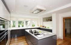 Expert kitchen designer Stuart Frazer worked with architects to make the most of the space and the result is a stunning kitchen that goes over and above expectations.