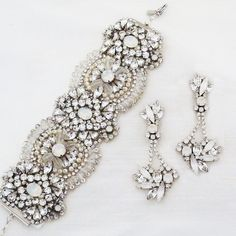 Statement bridal jewelry. Fabulous cuff by Haute Bride. Amazing chandelier earrings by Erin Cole. Love this combo for weddings & grand occasions.