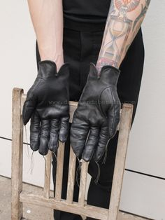Carol Christian Poell   O. tanned disparate leather gloves.