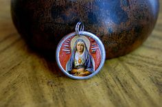 Our Lady of Sorrows devotional medal. $14.00, via Etsy.