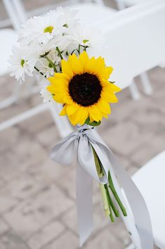 wedding aisle and sunflowers | Simple sunflower & daisy chair bouquets.