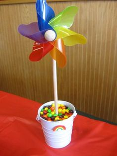 Great Idea for a rainbow party and for displaying pinwheels.  Colorful candy bucket idea too!  Check out this shop, Pinwheel Pretties, for tons of pretty pinwheels!