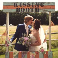 This bride and groom made their own kissing booth! Rebecca Douglas Photography #wedding #photography #bride #groom #DIY