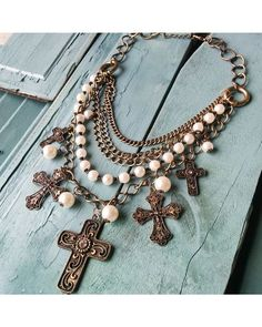Women's Antique Gold and Pearl Multi-Cross Necklace http://www.countryoutfitter.com/womens-antique-gold-and-pearl-multi-cross-necklace/2495228.html