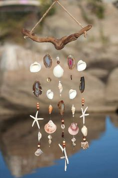 Beaded Wind Chimes Ideas - Earth tone colors of driftwood, agate and shells make this wind chime a one of a. Seashell Wind Chimes, Diy Wind Chimes, Seashell Art, Seashell Crafts, Beach Crafts, Diy And Crafts, Seashell Mobile, Crafts With Seashells, Driftwood Mobile