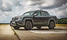 """Erkner Gruppe has revealed """"The Beast"""", a sinister-looking Volkswagen Amarok bakkie sporting a wrap and extra off-road equipment. Vw Amarok V6, Bull Bar, New Model, Offroad, Volkswagen, Beast, Automobile, Cars, Vehicles"""