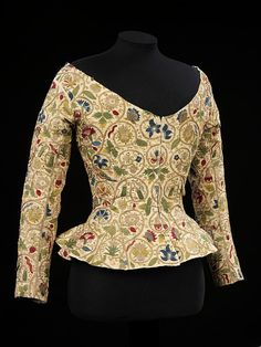 Jacket    Place of origin:    England, Great Britain (made)   Date:    1600-25 (made)    Artist/Maker:   Unknown (production)   Materials and Techniques:  Linen, embroidered with silk and metal thread, and spangles  Museum number:  1359-1900  Stylised red and white roses were the central symbol of the 16th century Tudor dynasty. Columbine flower was sometimes seen to signify sorrow.