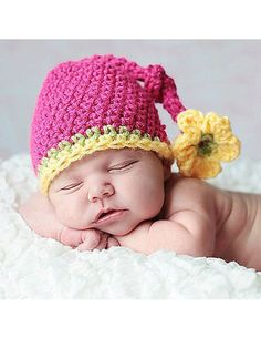 This darling hat is perfect for every little girl in your life! Use it as a photo prop or simply to keep Baby's head snug and warm -- this hat will be the envy of everyone! Size: Includes Newborn through 12 months. Made with medium (worsted) weight yarn and size H/8/5mm hook. Skill Level: Easy