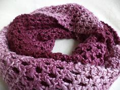 "This pattern is available as a free Ravelry download. ""Zeez"" is a quick knit scarf that uses just 1 skein of 100% luxurious silk, gradient colored yarn!  Gradient shades of a purplish pink, create a subtle 'Z' effect on the scarf.  This one page pattern is great for beginner knitters or more experienced knitters who want an easy project."