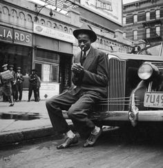 mrsdentonorahippo:  Baseball player Satchel Paige outside of a pool room in Harlem1941photo by George Strock