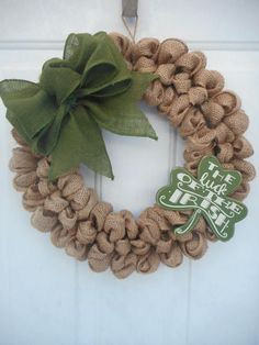 This is a handcrafted one of a kind wreath that Ive created using a 14 wreath form and generously looping 100% jute burlap around it resulting in the final dimensions being approximately 16. Ive then added a wide (4) green burlap ribbon bow as well as a Primitives by Kathy wooden