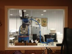 Here is an awesome picture my sister took from our cupping room window. That's our Diedrich Coffee Roaster. You can tell we were working, but it is still awesome.