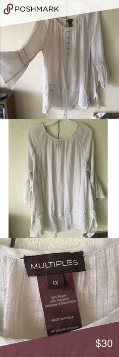 Gorgeous cream tunic blouse with crochet detail 1X Gorgeous cream tunic blouse with crochet detail and 3/4 flutter sleeves. Longer so is great with leggings or skinny jeans. Washed several times but never dried. Some minor piling. Size 1XL Tops Tunics