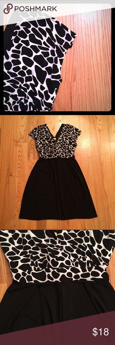 Animal Print Dress Soft with flair, this animal print dress has a flattering cut. V neck top. Polyblend. enfocus Dresses Midi
