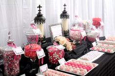 Elegant Candy and Dessert Buffet for a Beautiful Wedding in Scottsdale, AZ. The color palette was taken from the Bridal party colors. Black to match the Bridesmaid's dresses with Pink and white to match the flowers and Gray to coordinate with the Black and Gray Grooms tuxes. The Bride wanted a fun Candy and Dessert Table to treat her guests throughout the party. Lots of Candy, Cakeballs, chocolate covered oreos and cookies helped bring this table to a fun and inviting dessert…