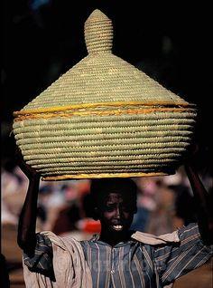 A big Injera basket on her head...Bhar Dar, Ethiopia | © Boaz Images