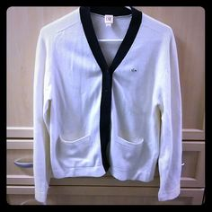 Lacoste Live large wool cardigan Almost new gently used Lacoste cardigan. 40%wool. 30%viscose. 20%polyamid. 10%cashmere - cream colour with black trim Lacoste Sweaters Cardigans