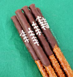 Chocolate Football Pretzel Rods – sweet and salty, dark and white chocolate dipped pretzel rods. A delicious game day treat that screams team spirit!