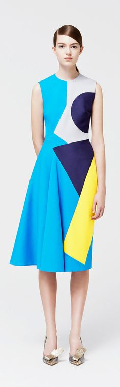 Shape - This is shape because of the distinct use of lines to create 2D geometric shapes that appear in the dress.