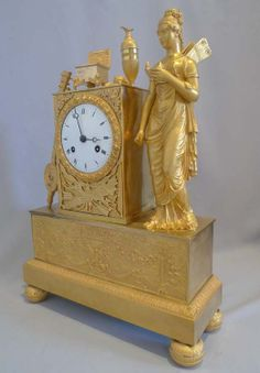 Antique French Empire ormolu clock of a Nike - Gavin Douglas Antiques