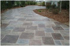 think maybe that dark brown tile color all over without a boarder.then maybe a slightly lighter brown for walkway?
