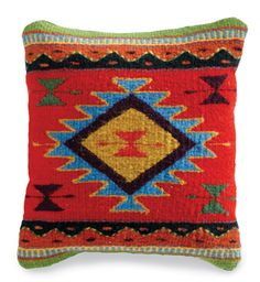 A colorful accent pillow inspired by traditional southwestern rugs is an easy way to tie together colors from around a room.