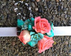 Check out this on trend snap bracelet corsage with coral roses, tiffany blue succulents and seed pearl accents.  Rose, Succulent & Hydrangea Wedding Flower Package.  By Fab Floral at fabfloral.net.