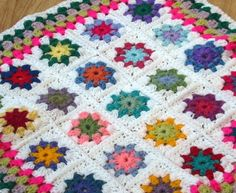 Granny Square Flower Blanket.  Might be pretty with a dark background, maybe brown, black or navy?