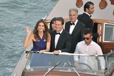 Model behaviour: Cindy Crawford could easily have been mistaken for a Bond Girl as she travelled to the opulent ceremony