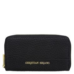 "Designer Christian Siriano never disappoints! The Cohen Wallet features a textured outer with goldtone accents, zipper close, lined interior with zippered coin pocket and ample room for ID, cash, phone and more.4 1/2""HX7 1/2""WX1""D. 100% Vinyl."