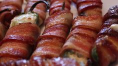 Cream cheese-filled jalapeno poppers are wrapped with bacon and grilled for this easy party snack.